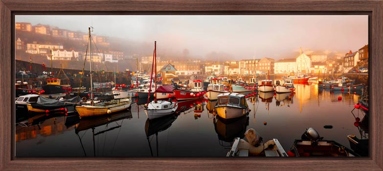 A calm and misty morning at Mevagissy harbour in Cornwall