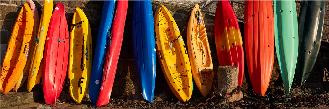 Colourful Kayaks at Mousehole - Canvas Print