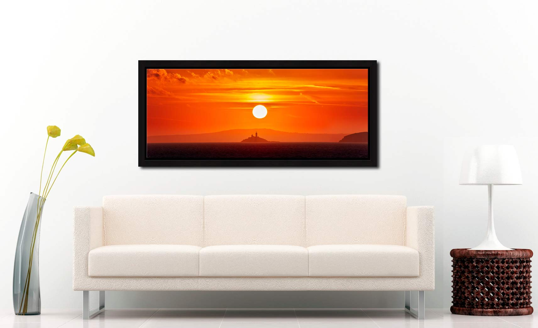 The golden sun rising over Godrevy Lighthouse in St Ives Bay - Black oak floater frame with acrylic glazing on Wall
