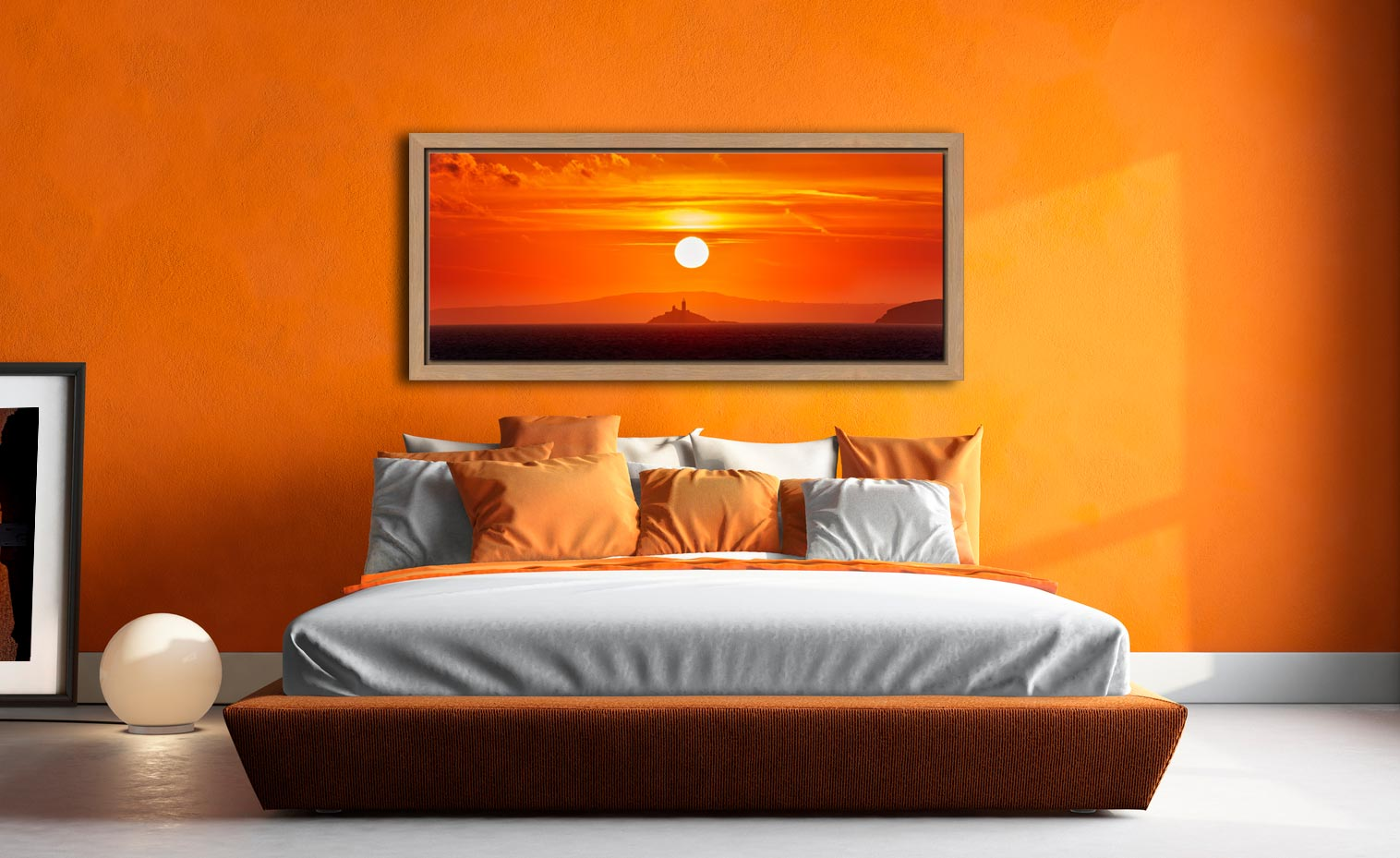 The golden sun rising over Godrevy Lighthouse in St Ives Bay - Oak floater frame with acrylic glazing on Wall