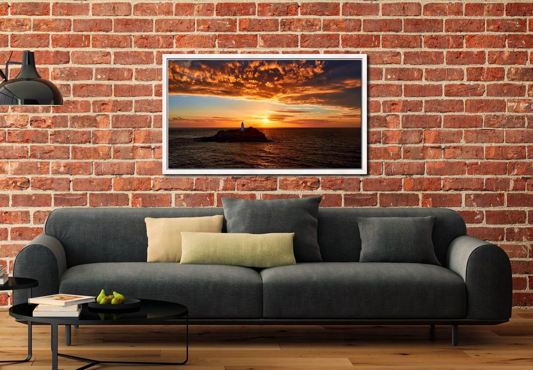 Sunset Over Godrevy Lighthouse - White Maple floater frame with acrylic glazing on Wall