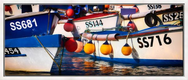 A tight group of colourful fishing boats in St Ives harbour, Cornwall
