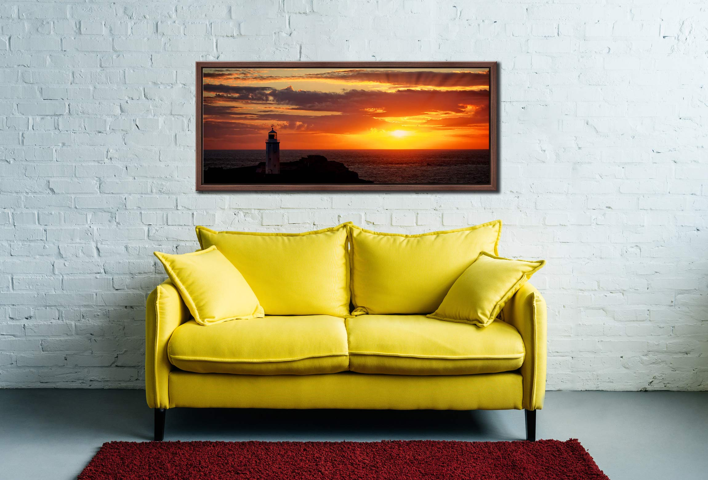 The golden sun beaming across the skies over Godrevy Lighthouse in Cornwall - Walnut floater frame with acrylic glazing on Wall