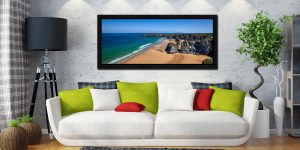 Beach and rock stacks at Bedruthan Steps in Cornwall on a beautiful sunny day - Black oak floater frame with acrylic glazing on Wall