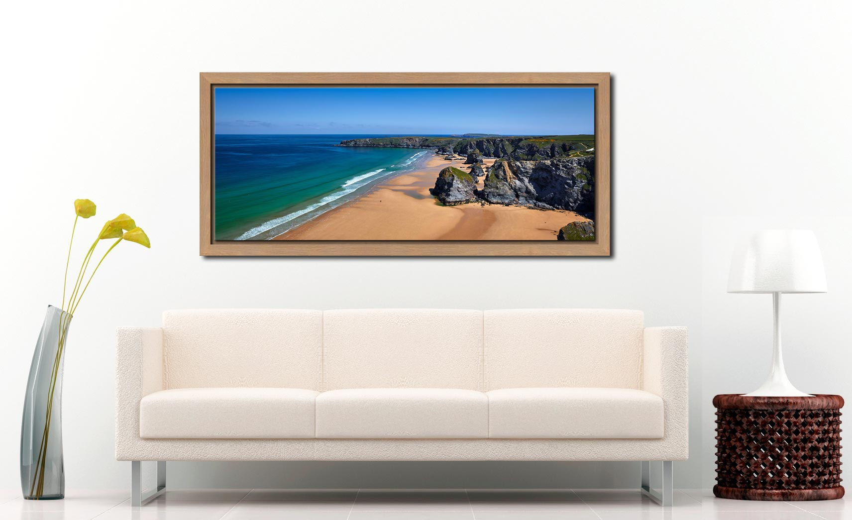 Beach and rock stacks at Bedruthan Steps in Cornwall on a beautiful sunny day - Oak floater frame with acrylic glazing on Wall