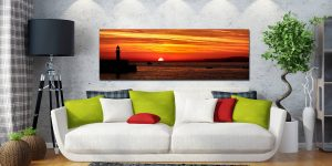 The peeking over the horizon in St Ives Bay in Cornwall. Golden skies above Smeaton's Pier and Godrevy Lighthouse - Print Aluminium Backing With Acrylic Glazing on Wall