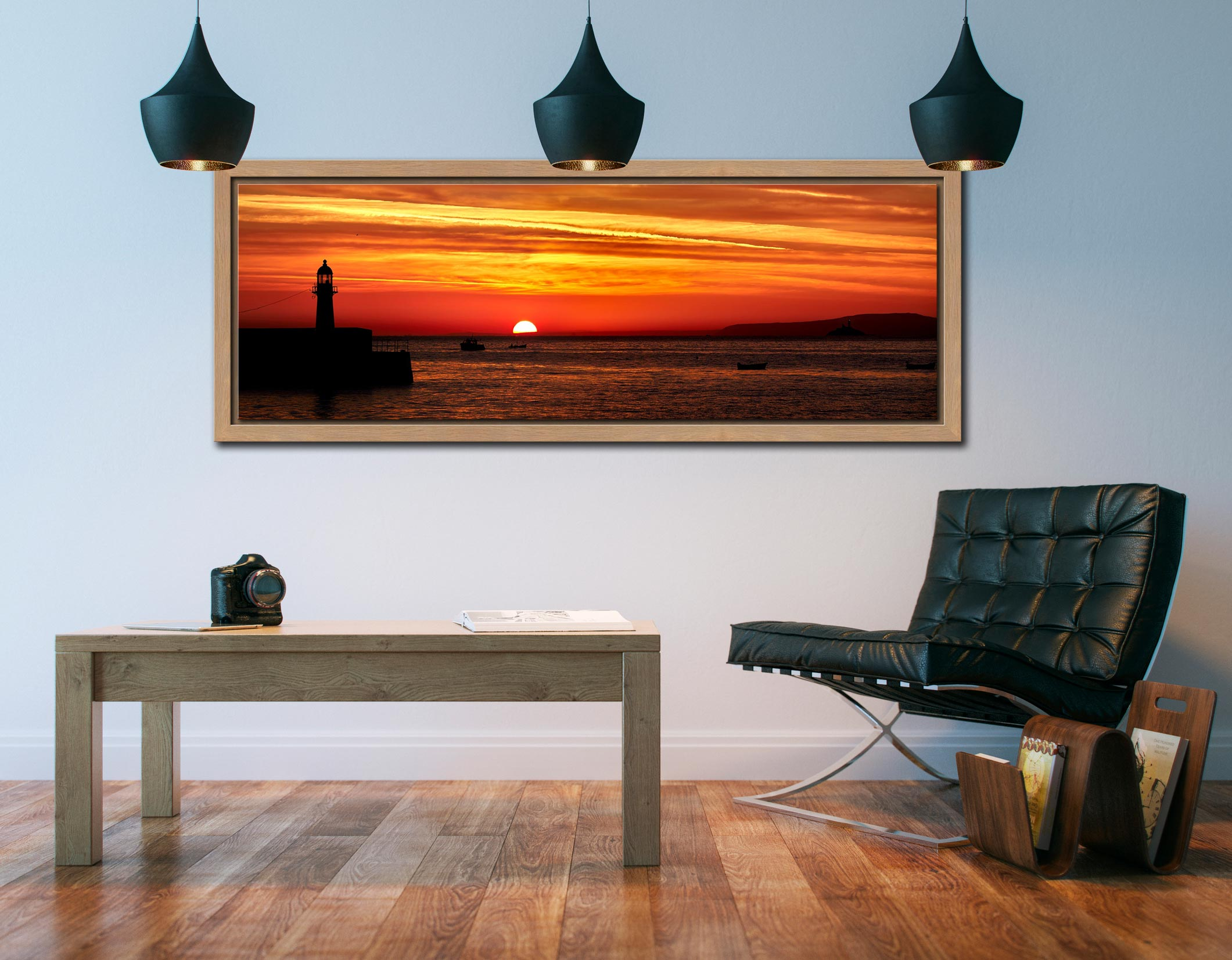 The peeking over the horizon in St Ives Bay in Cornwall. Golden skies above Smeaton's Pier and Godrevy Lighthouse - Oak floater frame with acrylic glazing on Wall