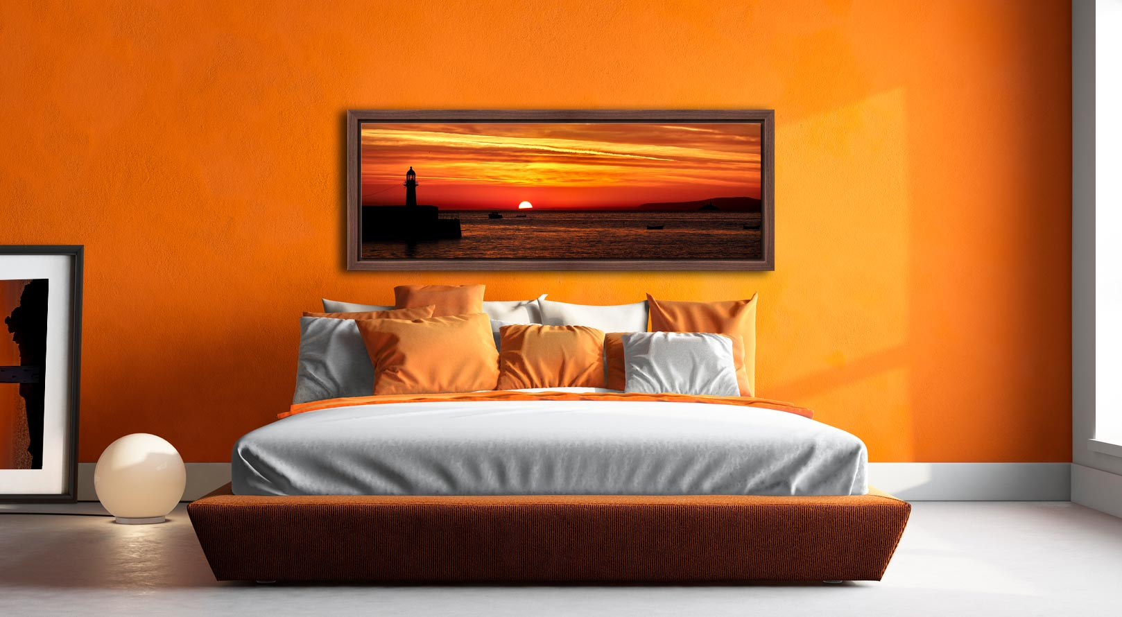 The peeking over the horizon in St Ives Bay in Cornwall. Golden skies above Smeaton's Pier and Godrevy Lighthouse - Walnut floater frame with acrylic glazing on Wall