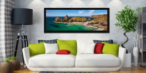 The tropical waters of Kynance Cove on the Lizard. The islands of The Bishop, Gull Rock and Asparagus Island - Black oak floater frame with acrylic glazing on Wall