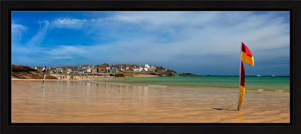 The golden sands and green waters of Porthminster Beach in St Ives