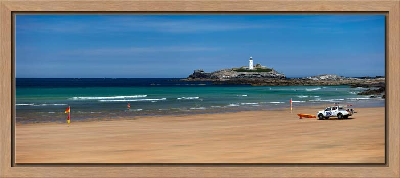 The golden sands of Godrevy Beach and Lighthouse in St Ives Bay