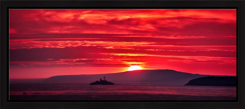 Red Sky in the morning over Godrevy Lighthouse